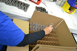 Packaging and Assembly, placing parts in plastic wrappers and then in a cardboard box